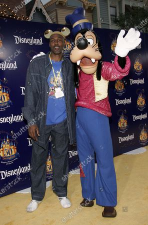 Karl Malone with Goofy at the Disneyland 50th Anniversary - The Happiest Celebration on Earth held at the Disneyland Resort in Anaheim, CA