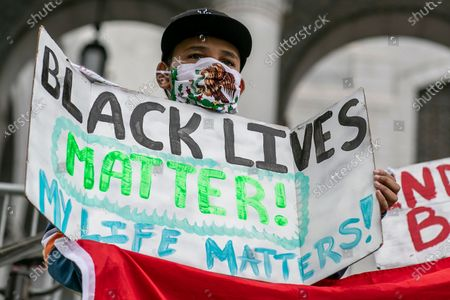 Los Angeles, CA, Sunday, June 28,2020 - Antwone Mendez, 12, joins hundreds of low riders and supporters outside City Hall protesting police brutality and systemic racism. (Robert Gauthier / Los Angeles Times)