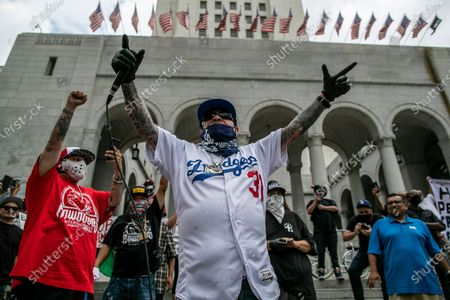"""Los Angeles, CA, Sunday, June 28,2020 - Kid Frost performs """"LaRaza"""" as hundreds of low riders gather outside City Hall protesting police brutality and systemic racism. (Robert Gauthier / Los Angeles Times)"""