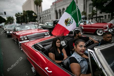Los Angeles, CA, Sunday, June 28,2020 - Maria Rodarte, with her children Andrea, Jose and Enrique Ruano, driving, join hundreds of low ridersoutside City Hall protesting police brutality and systemic racism. (Robert Gauthier / Los Angeles Times)