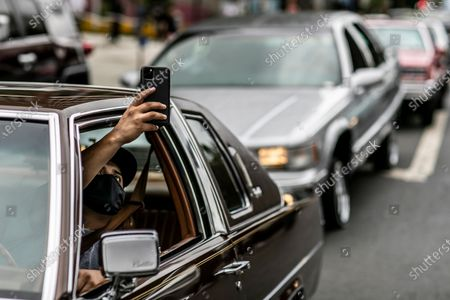 Los Angeles, CA, Sunday, June 28,2020 - Angel Neri of the Elegance car club joins other low riders outside City Hall protesting police brutality and systemic racism. (Robert Gauthier / Los Angeles Times)