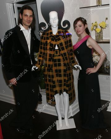 Rose McGowan, joined here by boutique owner Cameron Silver, at the launch of a clothing collection by Marilyn Lewis--legendary resteraunteur and author, now fashion designer--at Decades, a boutique, in West Hollywood, CA.
