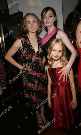 Rose McGowan, joined here by her sister, Daisy, and her niece, at the launch of a clothing collection by Marilyn Lewis--legendary resteraunteur and author, now fashion designer--at Decades, a boutique, in West Hollywood, CA.