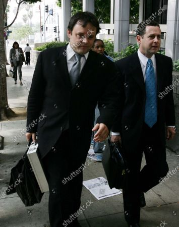 Photographer John Rutter--who is being sued by movie star Cameron Diaz on charges that he forged the star's signature on a model release form allowing him the sale and distribution of semi-nude photos of her that he took in 1992--leaving the downtown Los Angeles Courthouse with his lawyer Mark Werksman on the day that Cameron Diaz appeared as a witness on the stand and testified against him, in Los Angeles, CA.