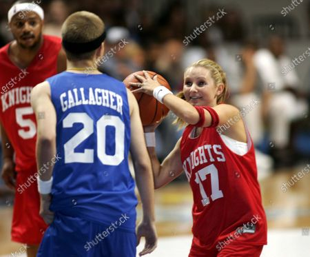 """David Gallagher tries to block Beverly Mitchell, both from the hit tv show """"7th Heaven"""", from scoring a basket at the Challenge For The Children All-Star Celebrity Basketball Game--in which """"The Knights"""" and """"The Daze"""", two teams of singers, actors, and athletes vie for bragging rights--part of the 7th Annual Challenge For The Children weekend in which NSYNC and celebrity friends have taken over the """"Windy City"""", Chicago, Illinois, for a series of events to raise funds and awareness for various children's charities; at the Allstate Arena in Chicago, Ill."""