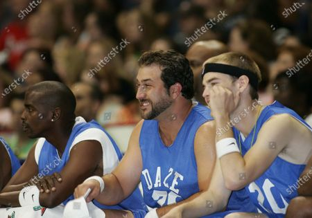 """Joey Fatone of NSYNC, and David Gallagher from the hit tv show """"7th Heaven"""", watch from the bench, at the Challenge For The Children All-Star Celebrity Basketball Game--in which """"The Knights"""" and """"The Daze"""", two teams of singers, actors, and athletes vie for bragging rights--part of the 7th Annual Challenge For The Children weekend in which NSYNC and celebrity friends have taken over the """"Windy City"""", Chicago, Illinois, for a series of events to raise funds and awareness for various children's charities; at the Allstate Arena in Chicago, Ill."""