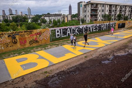 A newly painted Black Lives Matter sign is painted on the concrete path of the Atlanta Beltline pedestrian and bike trail in Atlanta, Georgia, USA, 01 July 2020. The message was painted in the wake of global protests demanding justice and racial equality sparked by the death of George Floyd while in Minneapolis police custody on 25 May.
