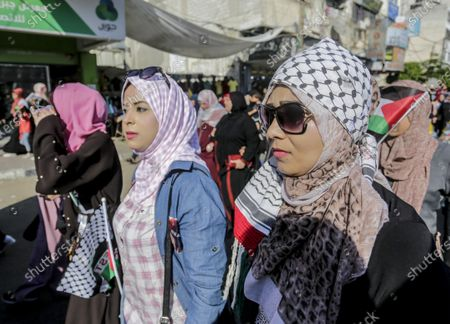 A protester wearing the Yasser Arafat signature scarf during a demonstration against Israel's annexation plans. Palestinian protesters gathered in the streets to denounce the controversial Israeli annexations in the occupied West Bank.