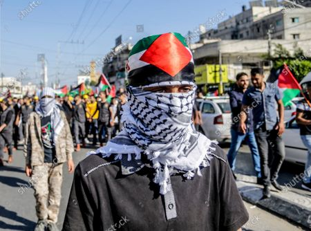 A masked protester with the Yasser Arafat signature scarf during a demonstration against Israel's annexation plans. Palestinian protesters gathered in the streets to denounce the controversial Israeli annexations in the occupied West Bank.