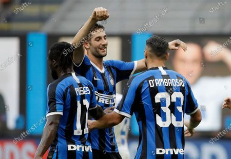 Inter Milan's Danilo D'Ambrosio, right, celebrates with his teammates Roberto Gagliardini, center, and Victor Moses after scoring his side's third goal during the Serie A soccer match between Inter Milan and Brescia at the San Siro Stadium, in Milan, Italy