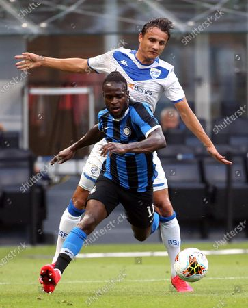 Inter Milan's Victor Moses (front) is fouled by Brescia's Ales Mateju during the Italian Serie A soccer match between FC Inter and Brescia Calcio at Giuseppe Meazza stadium in Milan, Italy, 01 July 2020.