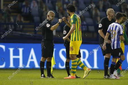 Referee David Webb and Ahmed Hegazy of West Bromwich Albion  bump hands at full time during the EFL Sky Bet Championship match between Sheffield Wednesday and West Bromwich Albion at Hillsborough, Sheffield