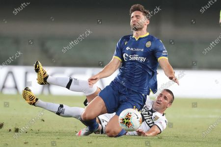 Hellas Verona's Fabio Borini (L) and Parma's Antonino Barilla' (R) in action during the Italian Serie A soccer match between Hellas Verona and Parma Calcio at Marcantonio Benteodi stadium in Verona, Italy, 01 July 2020.