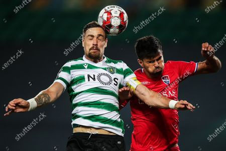 Sporting's Sebastian Coates (L) in action against Gil Vicente's Rodrigo (R) during the Portuguese First League soccer match between Sporting Lisbon and Gil Vicente at Alvalade Stadium in Lisbon, Portugal, 01 July 2020.