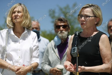 Janet Johnson of Pawcatuck, Ct., left, and her husband, Norman, center, listen as family friend Kimberly Obremski La Tourette of Lee, N.H., speaks at a news conference after the sentencing hearing for James Curtis Clanton in the death of Helene Pruszynski, Janet Johnson's younger sister, four decades ago, in Castle Rock, Colo. Clanton was sentenced to life in prison