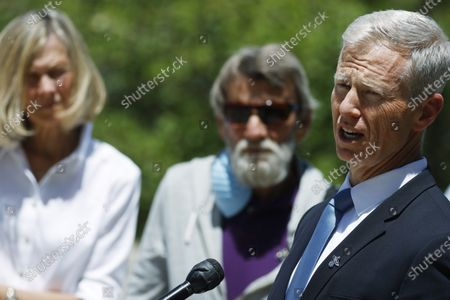 Stock Picture of Janet Johnson of Pawcatuck, Ct., back left, and her husband, Norman, listen as George Brauchler, 18th Judicial District Attorney speaks at a news conference after the sentencing hearing for James Curtis Clanton in the death of Helene Pruszynski, Janet Johnson's younger sister, four decades ago, in Castle Rock, Colo. Clanton was sentenced to life in prison