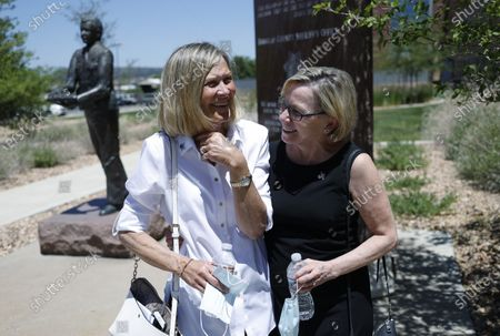 Janet Johnson of Pawcatuck, Ct., left, is hugged by Kimberly Obremski La Tourette of Lee, N.H., after a news conference after the sentencing hearing for James Curtis Clanton in the death of Helene Pruszynski, Johnson's younger sister, four decades ago, in Castle Rock, Colo. Douglas County, Colo., Sheriffs Department investigators solved the cold case that took place in early 1980