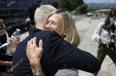Stock Image of Janet Johnson of Pawcatuck, Conn., right, hugs George Brauchler, 18th Judicial District Attorney following a news conference after the sentencing hearing for James Curtis Clanton in the death of Helene Pruszynski, Johnson's younger sister, four decades ago, in Castle Rock, Colo. Douglas County, Colo., Sheriffs Department investigators solved the cold case that took place in early 1980