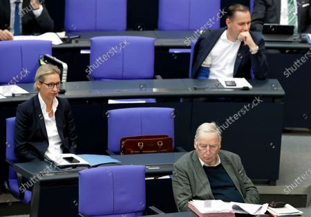 From left, Alice Weidel, co-faction leader of the Alternative for Germany party, Alexander Gauland, honorary chairman of the Alternative for Germany party, and Tino Chrupalla, co-chairman of the Alternative for Germany party, attend a meeting of the German federal parliament, Bundestag, at the Reichstag building in Berlin, Germany