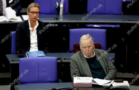Alice Weidel, left, co-faction leader of the Alternative for Germany party, and Alexander Gauland, right, honorary chairman of the Alternative for Germany party, attend a meeting of the German federal parliament, Bundestag, at the Reichstag building in Berlin, Germany