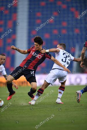 """Takehiro Tomiyasu (Bologna)Luca Pellegrini (Cagliari)Radja Nainggolan (Cagliari)                       during the Italian """"Serie A"""" match between Bologna 1-1 Cagliari at Renato Dall Ara Stadium on July 01 , 2020 in Bologna, Italy."""