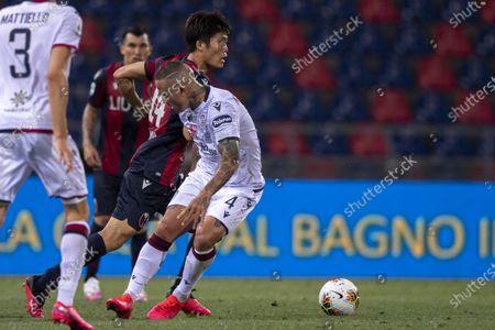 "Takehiro Tomiyasu (Bologna) Radja Nainggolan (Cagliari)          during the Italian ""Serie A"" match between Bologna 1-1 Cagliari at Renato Dall Ara Stadium on July 01 , 2020 in Bologna, Italy."