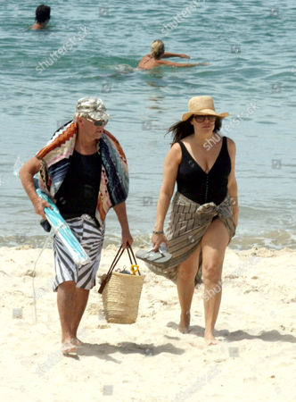 Editorial picture of Paul  Hogan and wife at Byron Bay, Australia - 26 Dec 2009