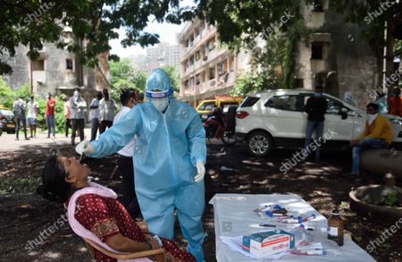 Stock Picture of A BMC healthcare worker take swab in the M ward, Deonar Best colony during Covid-19 pandemic  , on July 1, 2020 in Mumbai, India.