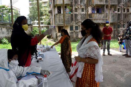 Editorial image of Medical Team Conducts  COVID-19 Coronavirus Test, Mumbai, Maharahstra, India - 01 Jul 2020