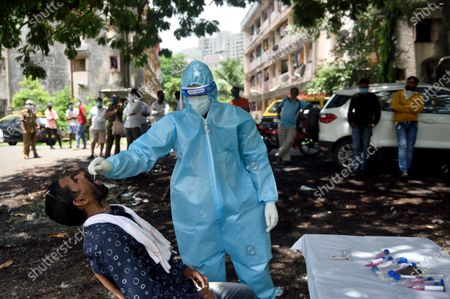 A BMC healthcare worker take swab in the M ward, Deonar Best colony during Covid-19 pandemic  , on July 1, 2020 in Mumbai, India.