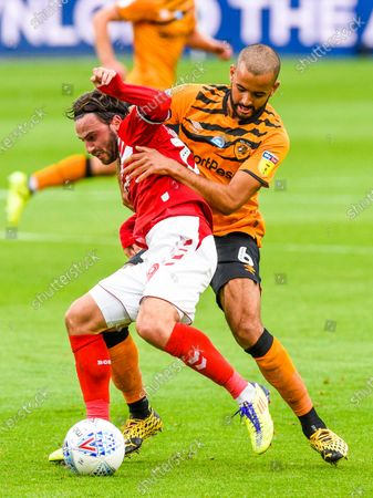 Patrick Roberts of Middlesbrough and Kevin Stewart of Hull City