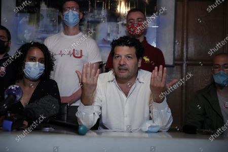 Stock Photo of Yasmina Kettal, a nurse at the Delafontaine Hospital in Saint-Denis in the Paris suburbs, left, and lawyer Aria Alimi attend a press conference, with members of the Collective Inter Urgences, to announce the filing of a four-count civil complaint alleging manslaughter, involuntary harm, voluntary failure to prevent damage and endangering the life of others, in Paris, . A collective of health care workers is seeking a broad legal inquiry into France's failure to protect them and colleagues and provide adequate masks, gloves and other protective equipment as the virus swept across the country
