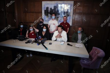 Stock Picture of Yasmina Kettal, a nurse at the Delafontaine Hospital in Saint-Denis in the Paris suburbs, third left, and lawyer Aria Alimi, second right, attend a press conference, with members of the Collective Inter Urgences, to announce the filing of a four-count civil complaint alleging manslaughter, involuntary harm, voluntary failure to prevent damage and endangering the life of others, in Paris, . A collective of health care workers is seeking a broad legal inquiry into France's failure to protect them and colleagues and provide adequate masks, gloves and other protective equipment as the virus swept across the country