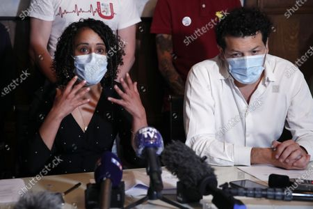 Yasmina Kettal, a nurse at the Delafontaine Hospital in Saint-Denis in the Paris suburbs, left, and lawyer Aria Alimi attend a press conference, right, with members of the Collective Inter Urgences, to announce the filing of a four-count civil complaint alleging manslaughter, involuntary harm, voluntary failure to prevent damage and endangering the life of others, in Paris, . A collective of health care workers is seeking a broad legal inquiry into France's failure to protect them and colleagues and provide adequate masks, gloves and other protective equipment as the virus swept across the country
