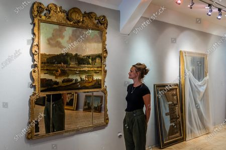 View of the park and Chateau of Saint Cloud from the Seine, by a follower of Frans van der Muelen, mounted in a George II carved giltwood overmantel trumeau mirror, 1600's, est £8-12,000 - Old Master Paintings Sale preview at Bonhams New Bond Street.