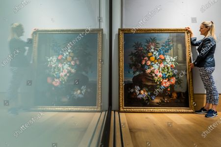 Jean-Baptiste Monnoyer (Lille 1636-1699 London), Still life of a basket of flowers by a column in a landscape with a King Charles spaniel, est £60,000-80,000 - Old Master Paintings Sale preview at Bonhams New Bond Street.