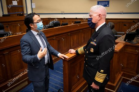 Rep. Andy Kim, D-N.J., left, speaks with Admiral Brett P. Giroir, M.D., Assistant Secretary for Health, at the conclusion of a House Oversight and Reform Committee hearing on 'The Administration's Efforts to Procure, Stockpile, and Distribute Critical Supplies' in the Capitol in Washington, DC, USA, 02 July 2020.