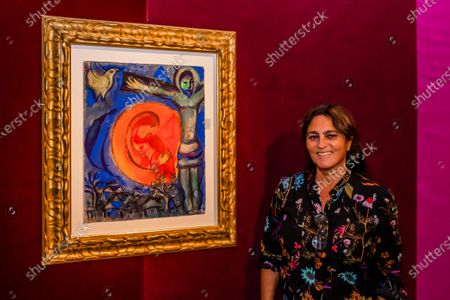 Stock Image of Soalnge with Marc Chagall, Christ au couple en rouge, Estimate: GBP 260,000 - GBP 360,000 - Christie's has now opened by appointment, only, in London and this week unveiled a Rainbow Room created by the jeweller Solange Azagury-Partridge, which is being created using fabric by Colefax and Fowler. Works from the online sale 'Dialogues: Modern & Contemporary Art' are installed in the room and the fabric will be donated to an NHS charity, that is creating 'Nest Rooms' in hospitals as respite spaces for staff on duty.