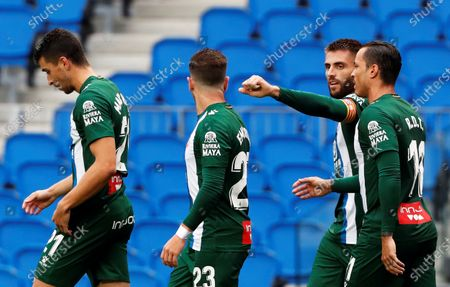 Espanyol's David Lopez (2-R) celebrates with teammates after scoring the 1-0 lead during the Spanish La Liga soccer match between Real Sociedad and RCD Espanyol at Reale Arena stadium in San Sebastian, northern Spain, 02 July 2020.