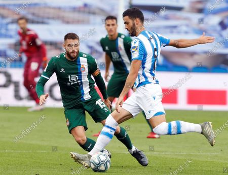 Real Sociedad's Merino (R) in action against Espanyol's David Lopez (L) during the Spanish LaLiga soccer match between Real Sociedad and Espanyol at Reale Arena stadium in San Sebastian, Basque Country, northern Spain, 02 July 2020.