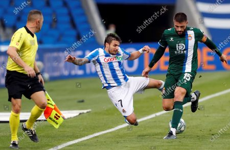 Real Sociedad's Cristian Portu (L) in action against Espanyol's David Lopez (R) during of the Spanish LaLiga soccer match between Real Sociedad and Espanyol at Reale Arena stadium in San Sebastian, Basque Country, northern Spain, 02 July 2020.