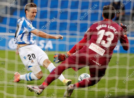 Real Sociedad's Monreal (L) in action against Espanyol's goalkeeper Diego Lopez (R) during a Spanish LaLiga soccer match between Real Sociedad and Espanyol at Reale Arena stadium in San Sebastian, Basque Country, northern Spain, 02 July 2020.