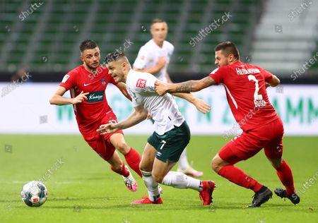 Milot Rashica (C) of Bremen in action against Marnon Busch (R) of Heidenheim during the German Bundesliga relegation playoff, first leg soccer match between Werder Bremen and FC Heidenheim in Bremen, Germany, 02 July 2020.