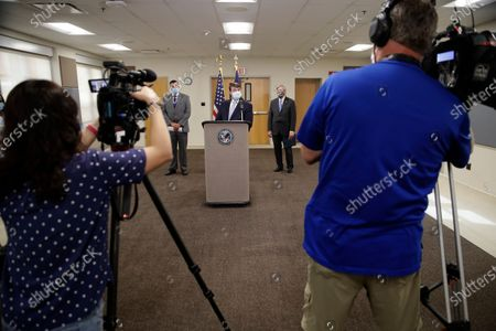 Robert Wilkie, center, secretary of Veterans Affairs, talks to reporters after touring the Kansas City VA Medical Center, in Kansas City, Mo. Civil rights organizations are pushing for changes at the hospital after numerous complaints from Black employees about harassment and discrimination