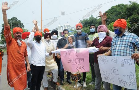 Stock Image of Members of the Sector 20 Gurdwara Committee and Chandigarh Youth Congress protest and raise slogans against Bollywood actor Anupam Kher over alleged remarks on Gurbani on July 2, 2020 in Chandigarh, India.