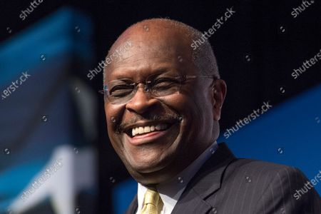 Herman Cain, CEO, The New Voice, speaks during Faith and Freedom Coalition's Road to Majority event in Washington. Cain is being treated for the coronavirus at an Atlanta-area hospital. That's according to a statement posted on his Twitter account