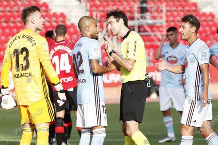 """Rafinha (Celta), Ricardo De Burgos Bengoetxea (Referee) - Football / Soccer : Spanish """"La Liga Santander"""" match between RCD Mallorca 5-1 RC Celta at the Son Moix Stadium in Palma de Mallorca, Spain."""