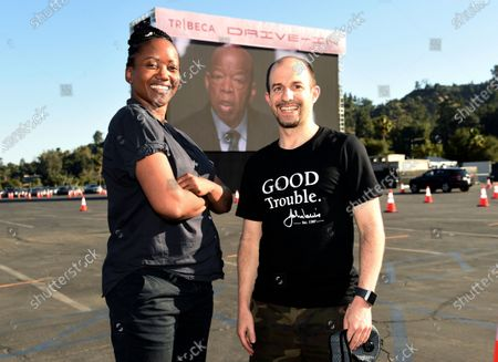 """Erika Alexander, left, and Ben Arnon, producers of the documentary film """"John Lewis: Good Trouble,"""" pose together as the film plays on the opening night of the Tribeca Drive-In, at the Rose Bowl in Pasadena, Calif. Complimentary access was offered to essential workers for the first night of the limited-engagement drive-in film series"""