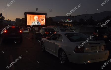 """Steven Spielberg, director of """"Jaws,"""" introduces the film on the opening night of the Tribeca Drive-In, at the Rose Bowl in Pasadena, Calif. Complimentary access was offered to essential workers for the first night of the limited-engagement drive-in film series"""