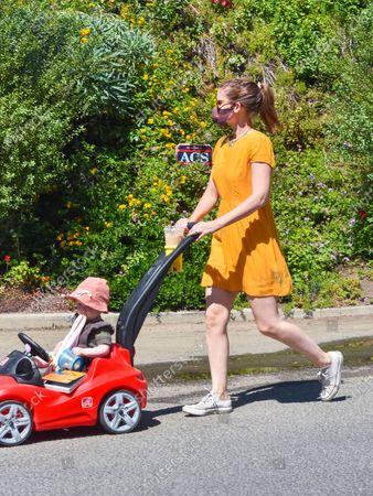 Kate Mara walking with her baby daughter